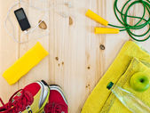 Frame with sports accessories and apple — ストック写真