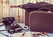 Old suitcases and a camera. Set traveler. Retro concept — Stock Photo