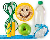 Bottle of water, muesli and green apple. Attributes of a healthy — Stock Photo