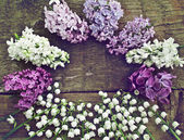 Unusual round frame of lilac and lily of the valley. Toning effe — Stock Photo