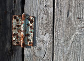 Old rusty metal door hinge — Stock Photo
