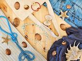 Women's clothing, beads and seashells — Stock Photo