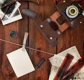 Retro camera, film and photos — Stock Photo