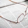 Newspapers and glasses — Stock Photo #30336827