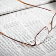Newspapers and glasses — Stock Photo
