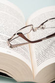 Glasses on book — 图库照片