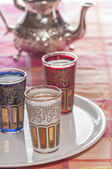 Decorated Moroccan tea glasses and teapot style — Stock Photo