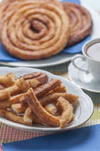 Churros with chocolate — Stock Photo