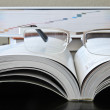 Reading Book with Glasses — Stock Photo