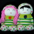 Stock Photo: Couple of handmade sock doll on isolated black background