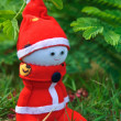 A Handmade sock doll of Santa Claus sitting on grass — Stock Photo