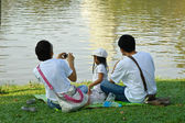 A family of three enjoying time at the park — Foto Stock