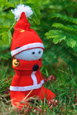 A Handmade sock doll of Santa Claus sitting on grass — ストック写真