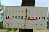 Rusty key hanging board with number — Stockfoto