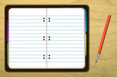 Notebook on Wooden Desk with Red Pencil — Stok fotoğraf