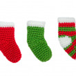 Green and red christmas sock ornaments on isolated white backgro — Stock Photo #44001653