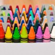 Collection of colorful wax crayons in boxes — Stock Photo #48118723