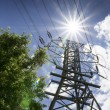 High Voltage Lines and Bright Sun Illustrate Summer Power Needs — Lizenzfreies Foto