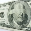 Stock Photo: Blindfolded Ben Franklin One Hundred Dollar Bill Illustrates Economic Uncertainty
