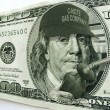 Ben Franklin on Hundred Dollar Bill Illustrates High Gas Prices — Photo