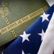 Stock Photo: Memorial Day Veteran's Remembrance with Military Service album and flag.