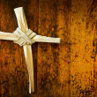Cross Made From Palm Sunday Branch on Old Wooden Bench — Stock Photo