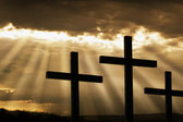 Three Crosses Silhouetted Against Breaking Storm Clouds — Stock Photo