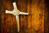 Cross Made From Palm Sunday Branch on Old Wooden Bench — Stock fotografie
