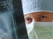 Healthcare Specialist Physician Surgeon Intensely Studies Xray Results before Surgery — Foto Stock