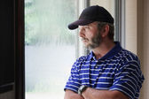 Adult Male Ponders Future Looking Out Rain Covered Window — Stock Photo