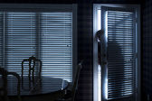 Burglar Breaking In To Home At Night Through Back Door — Stock Photo