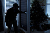 Burglar Breaking In To Home At Christmas Through Back Door — Stock Photo