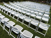 White folding chairs — Stock Photo