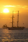 Sunset over two large sailing schooners — Stock Photo