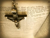 Handmade cross hanging over the Bible — Stock Photo