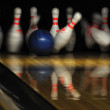 Stock Photo: Bowling ball hit pins