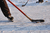 Hockey stick and ice skate in fragment of leisure hockey game — Foto de Stock