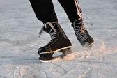 Closeup aggressive ice skating — Stock Photo