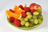 Isolated mix of fruits on plate — Stock Photo