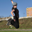 Woman jumps on inline skates — Stock Photo #35443987