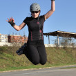 Woman jumps on inline skates — Stock Photo
