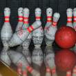 Bowling ball hits pins — ストック写真
