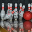 Bowling ball hits pins — Stock Photo