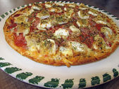 Fresh tasty pizza on decorated plate — Photo