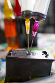 Printer ink refill syringe equipment. Ink stain fabric — Stock Photo