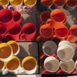 Colorful Ceramic pottery, coffee Mugs and cups for sale in a shop in the market. — Foto de Stock