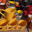 Colorful Ceramic pottery, coffee Mugs and cups for sale in a shop in the market. — Stock Photo #30624471