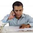Office employee working at his desk and talking on telephone — Stock Photo