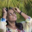 A Joyful, happy young woman under a pine tree, looking up. — Stock Photo