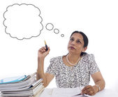 Thinking businesswoman with thought bubble — Stock Photo